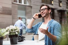 Cheerful handsome man speaking on the cellphone Stock Photos