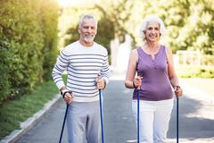 Sunday morning together for elderly couple in the park Stock Photos