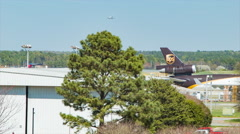 UPS Air Cargo Plane with Landing Airliner at RDU Stock Footage
