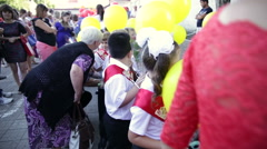 First graders with balloons. 1 September. Parents and children Stock Footage