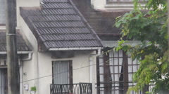 View on country houses from window, rainy gloomy day, bad mood and loneliness Stock Footage