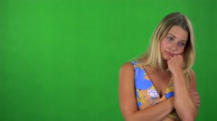 Young pretty blond woman is bored - green screen - studio  Stock Footage