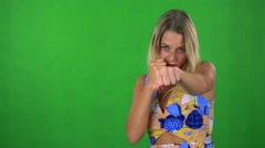 Young pretty blond woman does box - green screen - studio  Stock Footage