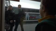 Slow motion in Saint-Petersburg, Russia little boy from the train window waving Stock Footage