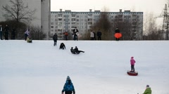 Moscow, Russia -28 February 2016. Children ride from snow hill in Zelenograd Stock Footage