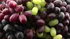 Slow zoom into purple, red, and green grapes sit in a cluster. Stock Footage