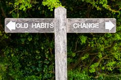 Old Habits versus Change directional signs Stock Photos
