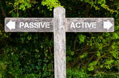 Passive versus Active directional signs Stock Photos