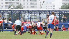 Many rugby players wrestle for a ball Stock Footage