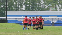 Warming up - Rugby team run on a field Stock Footage