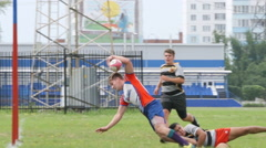 Rugby defenders block a player but he scores Stock Footage