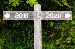 Year 2019 versus 2020 directional signs Stock Photos