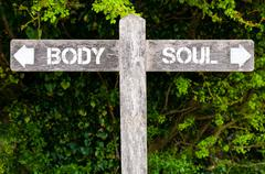 BODY versus SOUL directional signs Stock Photos