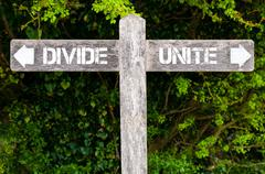 DIVIDE versus UNITE directional signs Stock Photos