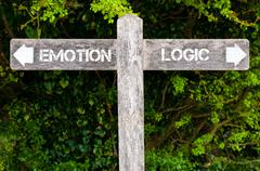 EMOTION versus LOGIC directional signs Stock Photos