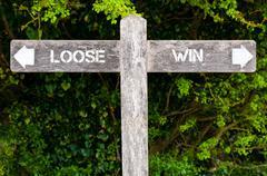 LOOSE versus WIN directional signs Stock Photos