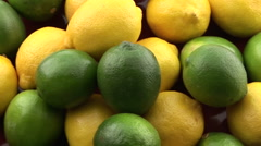 Lemons and limes spinning. Stock Footage