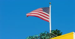 Blue sky  and American flag waving 4K, from RAW Stock Footage