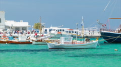 Fishing Boats in Clear Blue Mediterranean Water at Mykonos Greece Stock Footage