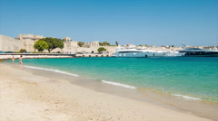 Rhodes Greece Beach at Akti Sachtouri with Old Town Background Stock Footage