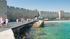 Tourists Walking Along Akti Sachtouri in Rhodes Greece Stock Footage