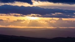 Dramatic Torrential Sunset Clouds over Hilly Landscape Stock Footage