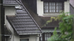 Rain falling on cozy cottages, downpour in old European village, weather Stock Footage