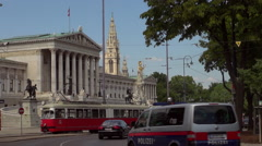 Austrian Parliament with Old fashioned tram, Red tram at Ringstrasse Stock Footage