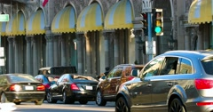 Luxury cars traffic and tourists near Beverly Wilshire Hotel in Beverly Hills 4K Stock Footage
