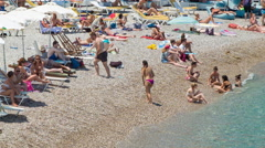 People Close-upon Eli Beach in Rhodes Greece Stock Footage
