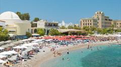 People Enjoying Eli Beach in Rhodes Greece Stock Footage