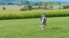 Family running on the field Stock Footage