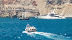 Santorini Greece Yachts with Tendering Cruise Passengers Stock Footage
