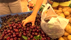 Filling in a bag with black cherry Stock Footage
