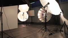 Photographer Silhouette in Photographic Studio with a big Umbrella Stock Footage