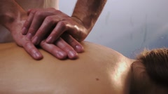 Male hands massaging patient's back Stock Footage