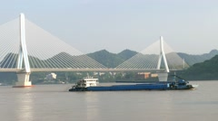 China Yichang Yangtze River Highway Bridge with river freighter Stock Footage