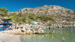 Rhodes Greece Visitors Swimming at Anthony Quinn Bay Stock Footage