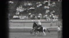 1941: sparsely packed rodeo has cowboys having a good time after all on a fun Stock Footage