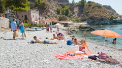 Taormina Sicily People Sunbathing on European Beach Stock Footage