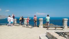 Taormina Sicily Tourists Overlooking the Italian Destination Stock Footage