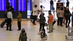 People Waiting In Check-In Counters At Suvarnabhumi Airport , Bangkok, Thailand. Stock Footage