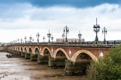 Old stony bridge in Bordeaux, France Europe Stock Photos