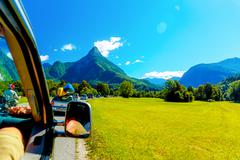 Free summer car travelling road trip in beautiful mountain landscape Stock Photos