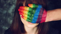 4k LGBT Shot of Rainbow Coloured Hands Man on Woman's Eyes Stock Footage