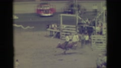 1941: a rodeo cowboy in western gear riding a bucking bronco until it stops. Stock Footage