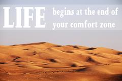 Desert with text: Life begins at the end of your comfort zone Stock Photos