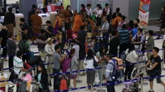 People Waiting In Check-In Counters At Suvarnabhumi Airport , Bangkok, Thailand. Stock Footage