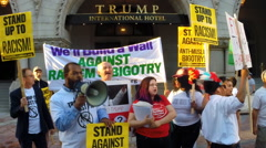 Protest of Trump Hotel and demonstrators say he's racist  Stock Footage