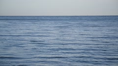 Blue sea or ocean with smooth water surface Stock Footage